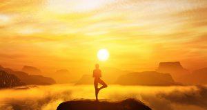 Woman-meditating-above-mountain-clouds-on-sun-down.jpg